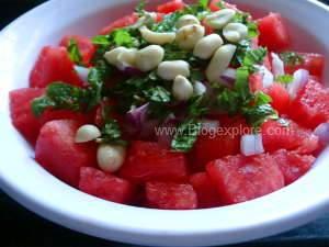 adding peanuts for watermelon mint salad