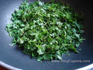 adding greens for keerai kootu recipe