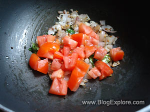 adding tomatoes for potato tomato fry recipe