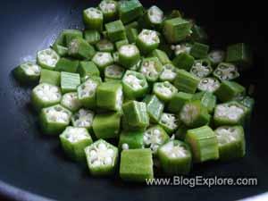 adding okras for dahi bhindi recipe