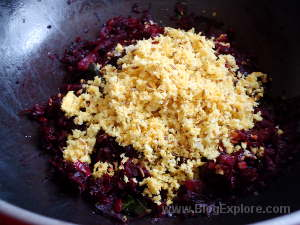 adding coconut for beetroot thoran recipe