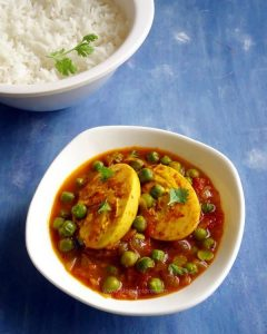 egg and peas curry recipe - a delicious Indian style boiled eggs and green peas curry. Goes well with rotis and rice.