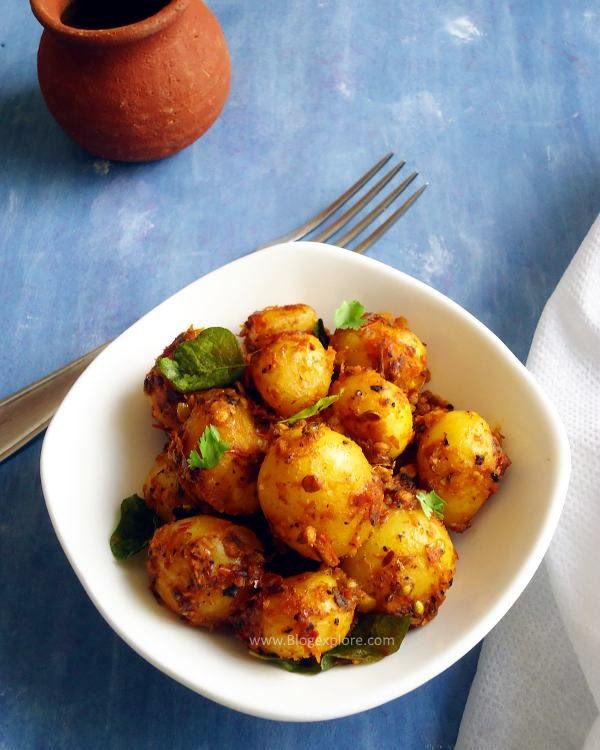 baby potato fry recipe - a South Indian style baby potato fry with aromatic spices. Good side dish for rice, rotis and poori.