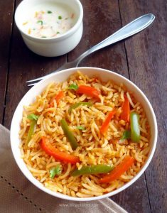 capsicum rice recipe - a delicious capsicum masala rice using bell peppers and flavored with spices.