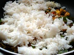 adding rice for making indian style egg fried rice