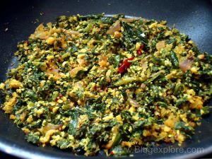 stir frying radish leaves and coconut for radish greens stir fry