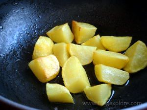 frying potatoes for bengali egg curry