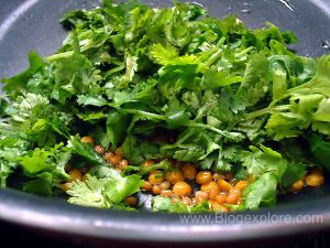adding coriander leaves for green coconut coriander chutney