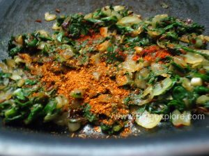 adding masala spices for spinach potato sandwich