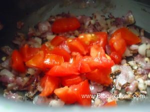 adding tomatoes for spinach dala