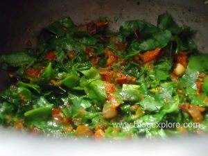 stirring moong and palak for spinach dal