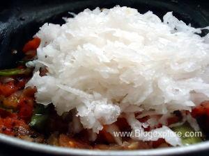 adding grated white radish for radish egg poriyal