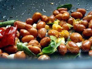 adding spices for masala pori