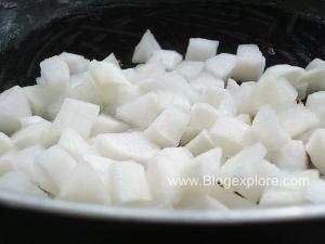 adding radish for mooli ki sabzi