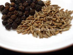 grinding milagu and jeeragam for pepper sevai