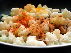 adding spices to gobi for cauliflower pulao