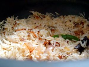 stirring rice and spices for cauliflower pulao