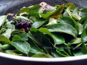adding tamarind for curry leaves chutney