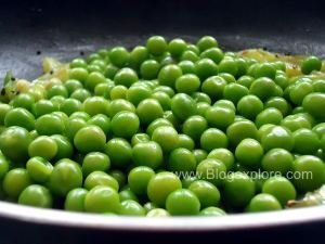 adding matar for green peas capsicum stir fry