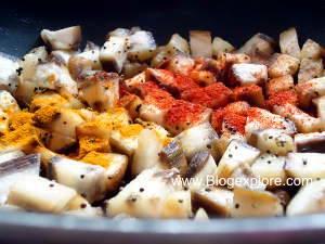 adding spices for vazhakkai fry