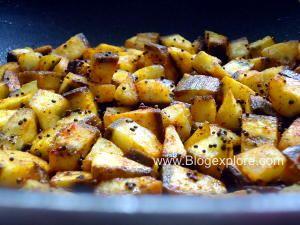 frying raw banana with spice masala for vazhakkai fry
