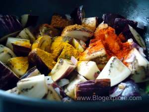 adding spices for brinjal fry